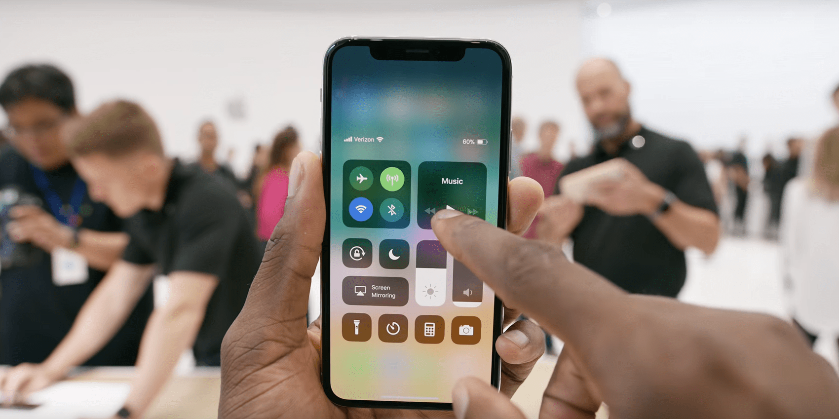 access the Control Center on the iPhone X